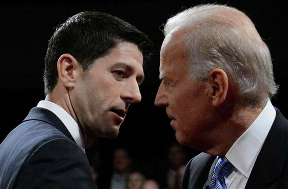 Vice President Joe Biden and Republican vice presidential nominee Rep. Paul Ryan of Wisconsin shake hands after the vice presidential debate at Centre College, Thursday, Oct. 11, 2012, in Danville, Ky. (AP Photo/Pool-Michael Reynolds) / AP2012
