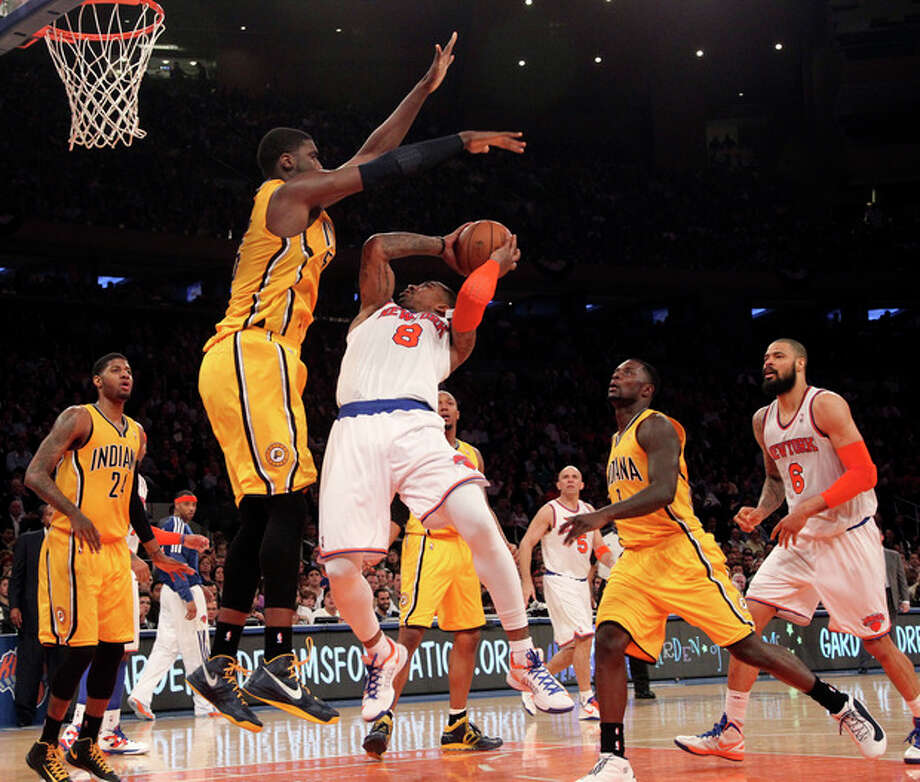 Indiana Pacers' Roy Hibbert, second from left, blocks New York Knicks' J.R. Smith from going to the basket in the second half of Game 2 of their NBA basketball playoff series in the Eastern Conference semifinals at Madison Square Garden in New York, Tuesday, May 7, 2013. The Knicks won 105-79. (AP Photo/Mary Altaffer) / AP
