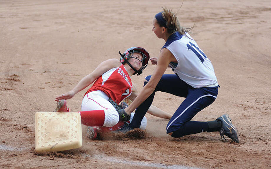 Hour photo/John NashStaples pitcher Nikki Bukovsky, right, puts the tag on Greenwich's Rebecca DeCarlo on a play at third base in the first inning of Friday night's FCIAC softball game in Westport. Greenwich eked out a 2-1 win over the host Wreckers.