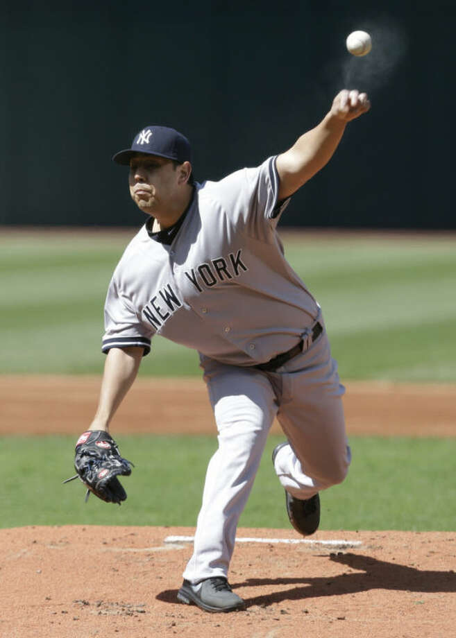 New York Yankees starting pitcher Vidal Nuno pitches in the first inning in the second baseball game of a doubleheader against the Cleveland Indians, Monday, May 13, 2013, in Cleveland. (AP Photo/Tony Dejak)