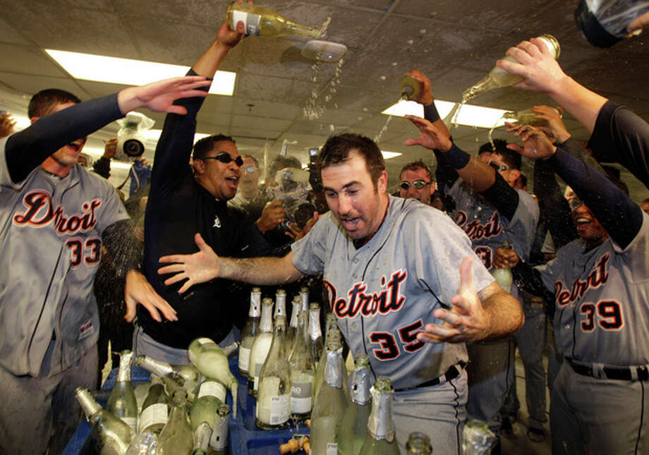 Detroit Tigers' Justin Verlander (35) is drenched with sparkling wine by teammates at the end of Game 5 of during the American League division baseball series in Oakland, Calif., Thursday, Oct. 11, 2012. (AP Photo/Ben Margot) / AP