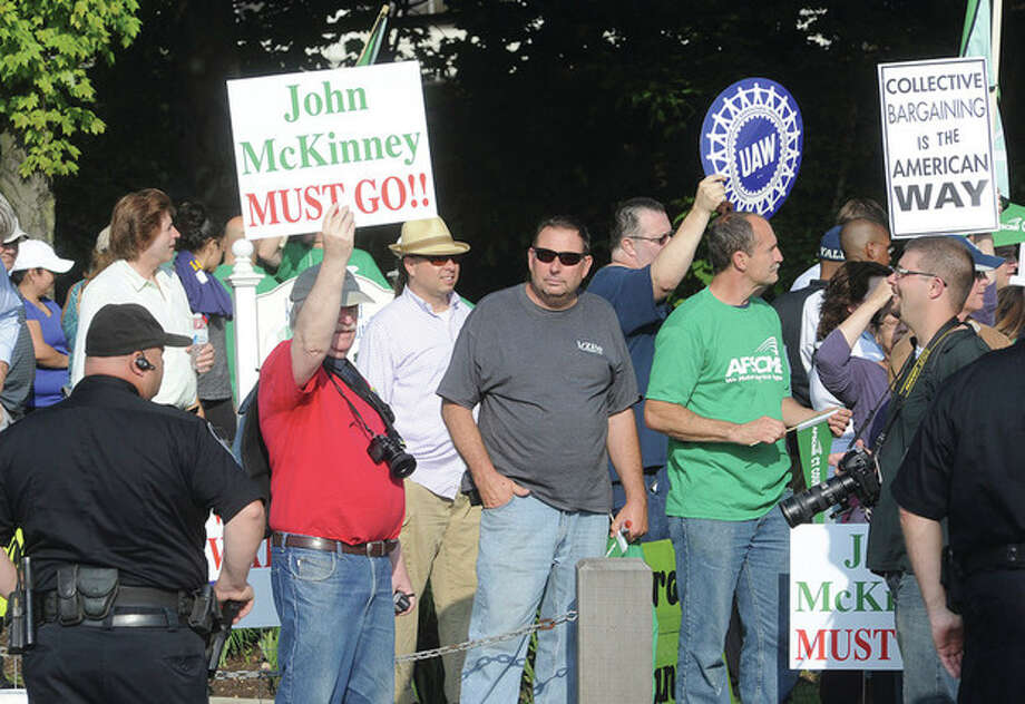 Union members, clergy and others protest outside of the Stamford Hilton Hotel Monday against Senate Republican Leader John McKinney and Walker, who appeared at the Prescott Bush Awards dinner. / (C)2011 {your name}, all rights reserved