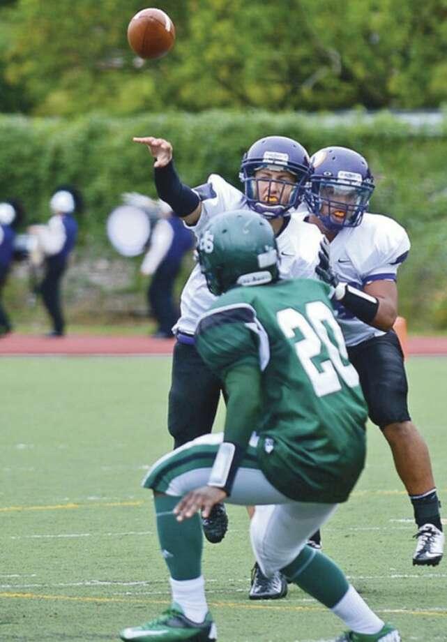 Westhill quarterback Sean Remondino looks to throw against Norwalk during their game in Stamford Saturday.Hour photo / Erik Trautmann
