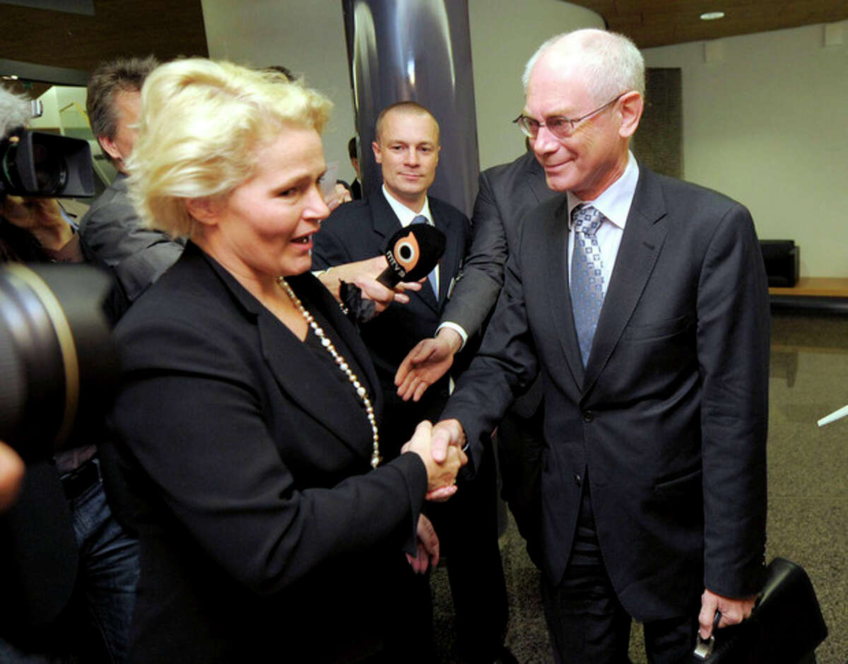 """The Grand Committee's chairman Mia-Petra Kumpula, left, welcomes European Union President Belgian Herman Van Rompuy, right, as he arrives to The Grand Committee at the Parliament house in Helsinki, Finland, Friday Oct. 12, 2012. The Norwegian Nobel Prize Committee announced Friday that the EU receives the award for six decades of contributions """"to the advancement of peace and reconciliation, democracy and human rights in Europe."""" (AP Photo / LEHTIKUVA, Jussi Nukari) FINLAND OUT - NO SALES"""