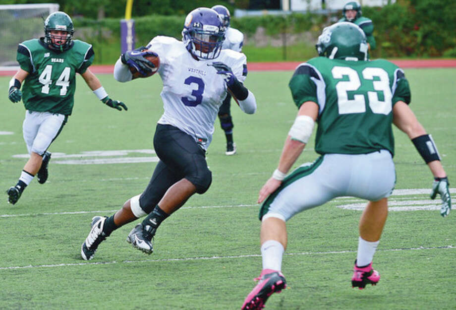 Westhill #3 Moise Francillon advances the ball against the Norwalk defense during their game in Stamford Saturday.Hour photo / Erik Trautmann / (C)2012, The Hour Newspapers, all rights reserved