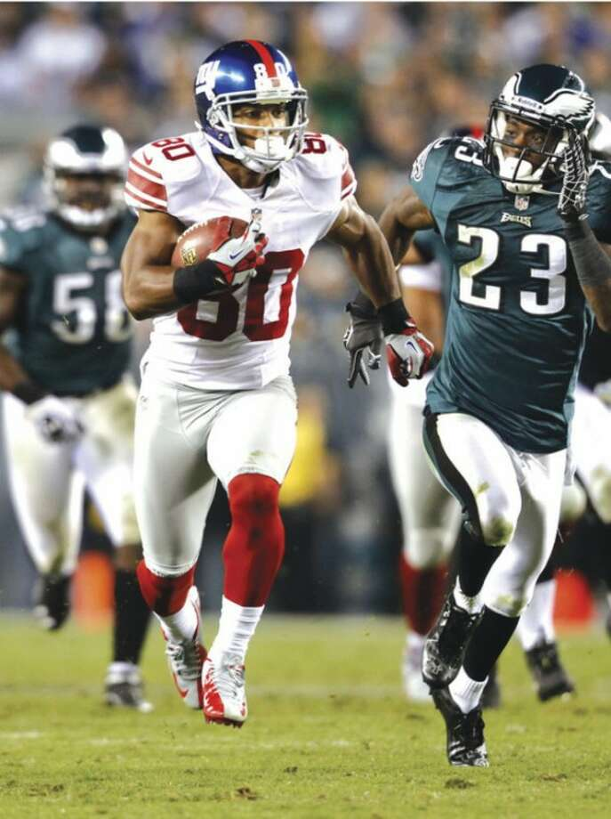 New York Giants wide receiver Victor Cruz (80) runs with the ball as Philadelphia Eagles corner back D. Rodgers-Cromartie (23) tries to catch up during an NFL football game Sunday, Sept. 30, 2012, in Philadelphia. (AP Photo/Mel Evans)