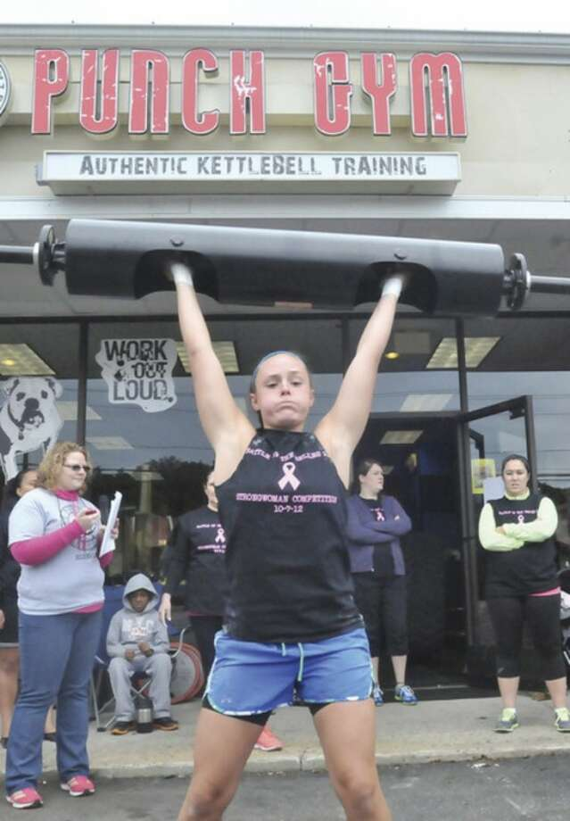 Jill Funk in the Battle of the Belles competion Sunday at the Punch KettleballGym's annual cancer fundraiser in Norwalk. hour photo/Matthew Vinci