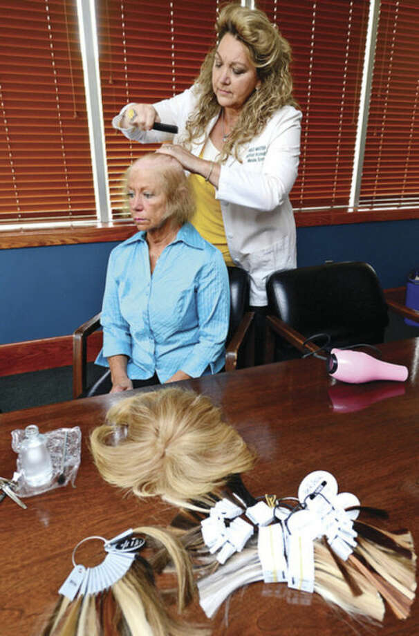 Hour photos / Erik TrautmannHair Loss Clinic for Women founder Marsha Scott and client Patty Andrews demonstrate in above sequence of photos the process that the clinic provides to help restore the confidence of women who are experiencing hair loss from a variety of causes.
