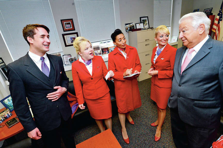 Mayor Richard Moccia greets Virgin Airline flight attendants Ros Lauder, Rhian Tippett, Beverly Williams and Julie Sykes during a promotional visit touting theirnew morning flights to Europe from JFK.Hour photo / Erik Trautmann / (C)2012, The Hour Newspapers, all rights reserved