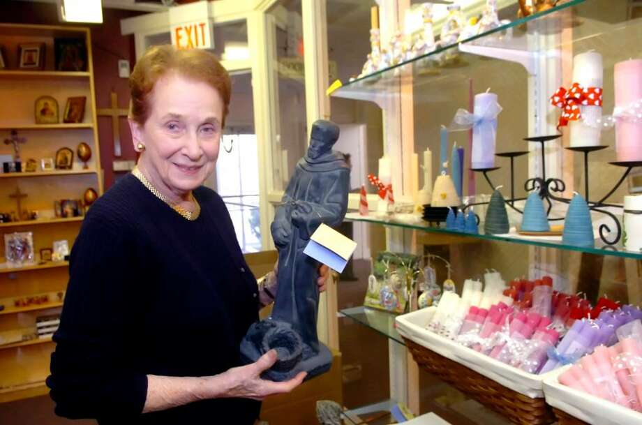 Mary Jane Marks, owner of the Christ Church Gift and Book Shop in Greenwich, holds a statue of St. Francis, on Thursday, March 25, 2010. Photo: Helen Neafsey / Greenwich Time
