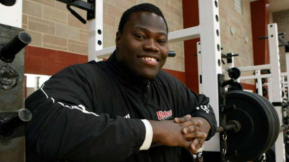 University of Massachusetts offensive tackle Vladimir Ducasse, originally from Haiti, poses for a photograph in a gym on the school's campus, in Amherst, Mass. Photo: File Photo / Stamford Advocate File Photo