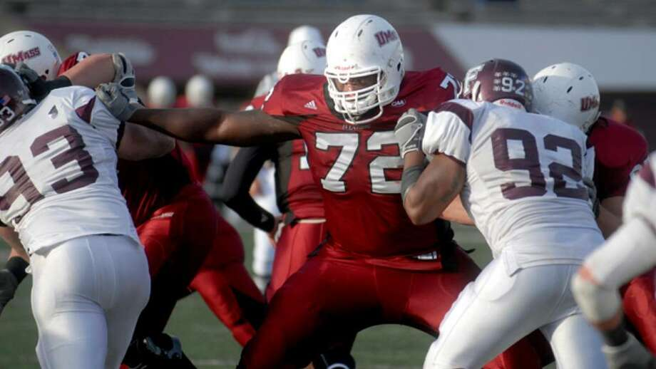 Former Stamford High School standout lineman Vladimir Ducasse is the immovable object in the offensive line for the #7 ranked University of Massachusetts Minutemen as the team's starting left tackle. Photo: File Photo / Stamford Advocate File Photo
