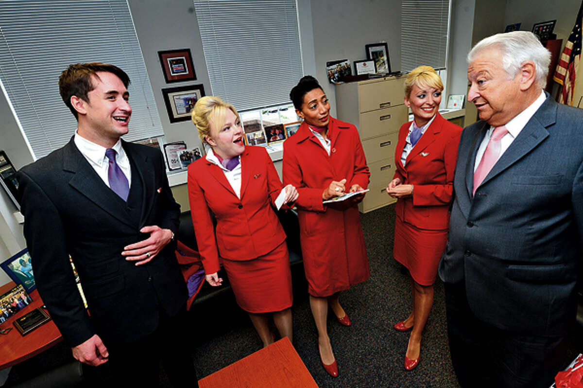 Mayor Richard Moccia greets Virgin Airline flight attendants Ros Lauder, Rhian Tippett, Beverly Williams and Julie Sykes during a promotional visit touting theirnew morning flights to Europe from JFK. Hour photo / Erik Trautmann