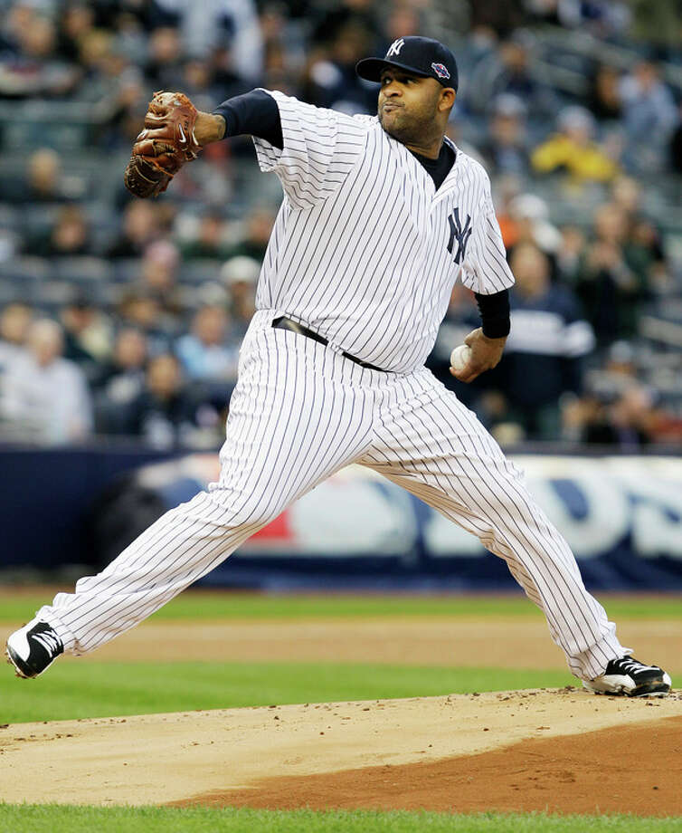New York Yankees' CC Sabathia delivers a pitch during the first inning of Game 5 of the American League division baseball series against the Baltimore Orioles, Friday, Oct. 12, 2012, in New York. (AP Photo/Kathy Willens) / AP