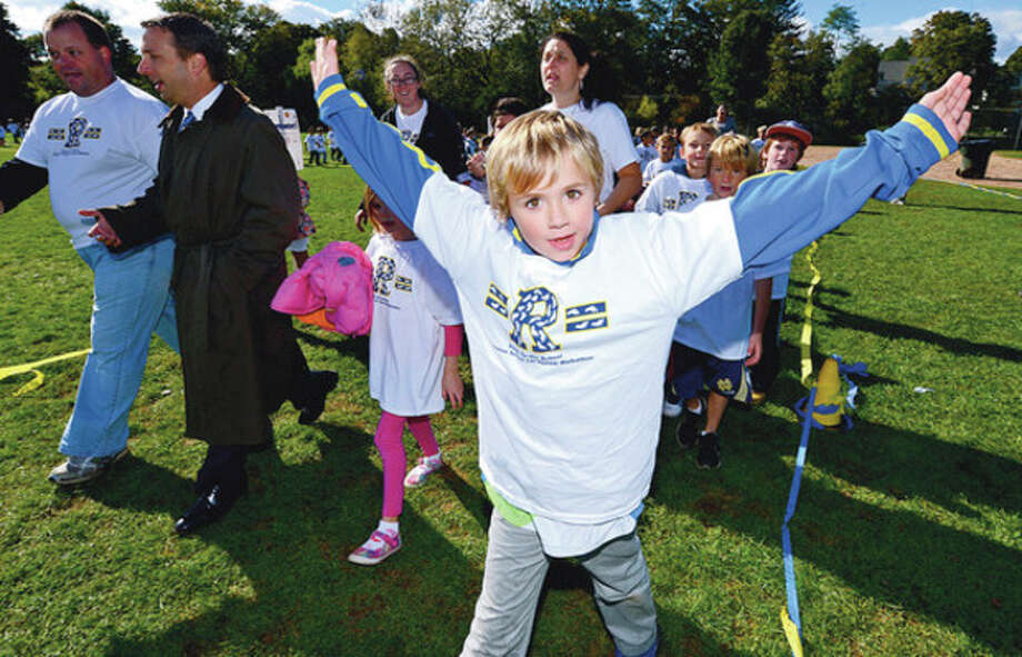 Students at Rowayton Elementary School students including Jake Palmer conduct their walk-a-thon Friday that raised nearly $20,000 for a new computer lab.Hour photo / Erik Trautmann / (C)2012, The Hour Newspapers, all rights reserved