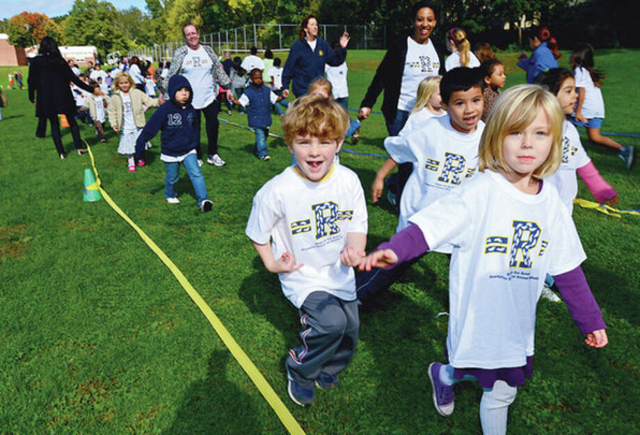 Hour photos / Erik TrautmannAbove, students at Rowayton Elementary School including kindergartners Ben Kammerer and Pia Steinborn conduct their walk-a-thon Friday that raised nearly $20,000 for a new computer lab. Below, Rowayton Elementary School students including fifth-graders Karlys Nesa, Jadis Vigo and Natalie Ramos participate. / (C)2012, The Hour Newspapers, all rights reserved