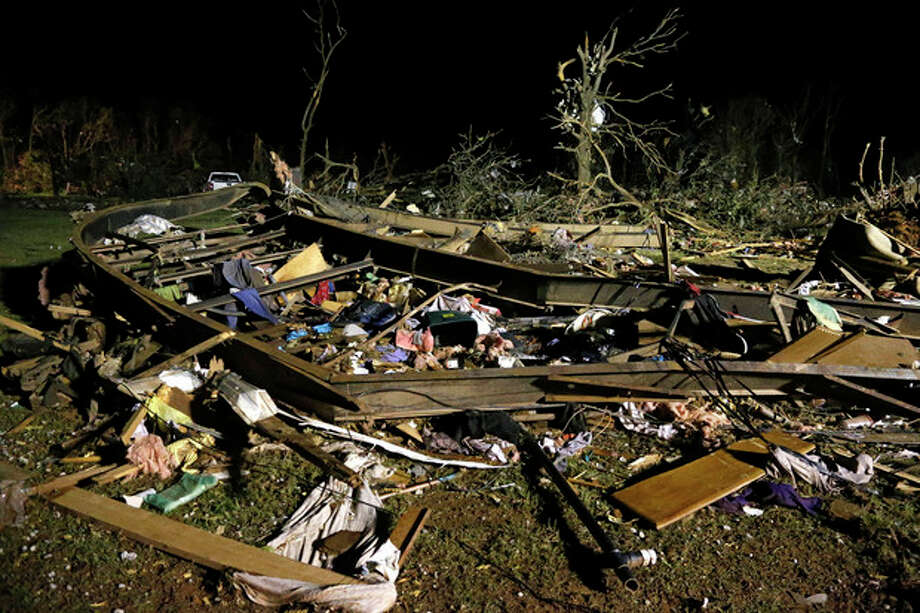 The frame of a mobile home is pictured with debris after a tornado hit a mobile home park near Dale, Okla., Sunday, May 19, 2013. (AP Photo Sue Ogrocki) / AP