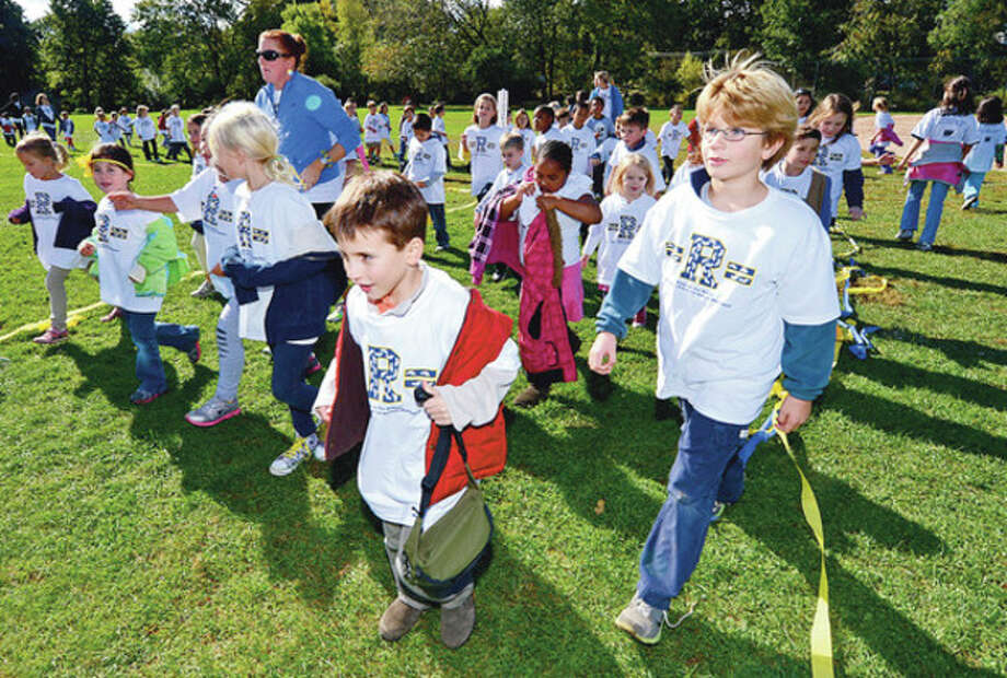 Students at Rowayton Elementary School students conduct their walk-a-thon Friday that raised nearly $20,000 for a new computer lab.Hour photo / Erik Trautmann / (C)2012, The Hour Newspapers, all rights reserved