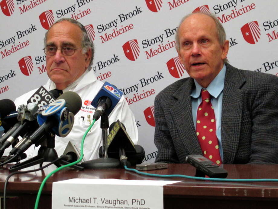 Michael T. Vaughan, a research professor at Stony Brook University Hospital, right, speaks during a news conference about the possibility that he contracted the potentially deadly hantavirus while camping in the Adirondack Mountains, Friday, Oct. 12, 2012 at Stony Brook, N.Y. Dr. Roy Steigbigel, left, an infections disease specialist at Stony Brook University Hospital, who helped treat Vaughan, is awaiting test results from New York state and federal experts to confirm suspicions that Vaughan had the disease. He has since recovered. (AP Photo/Frank Eltman) / AP