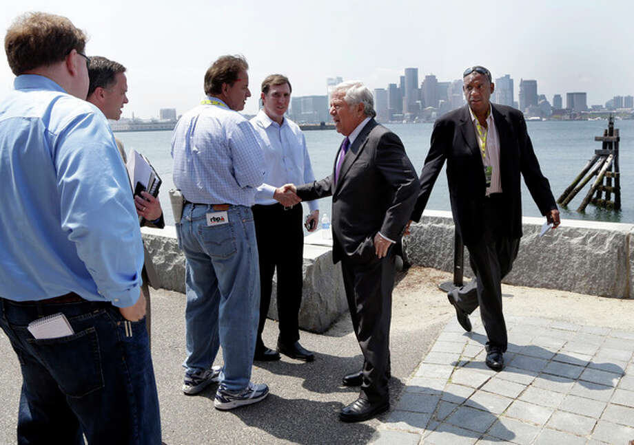 New England Patriots football team owner Robert Kraft, second from right, speaks with reporters during a break in the NFL spring meeting in Boston, Tuesday, May 21, 2013. (AP Photo/Elise Amendola) / AP
