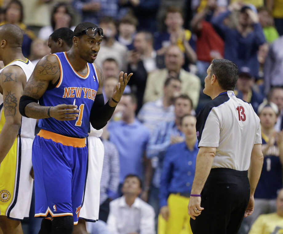 New York Knicks' Amare Stoudemire argues with referee Monty McCutchen after being called for a technical foul during the first half of Game 4 of an Eastern Conference semifinal NBA basketball playoff series against the Indiana Pacers on Tuesday, May 14, 2013, in Indianapolis. The Pacers won 93-82. (AP Photo/Darron Cummings) / AP