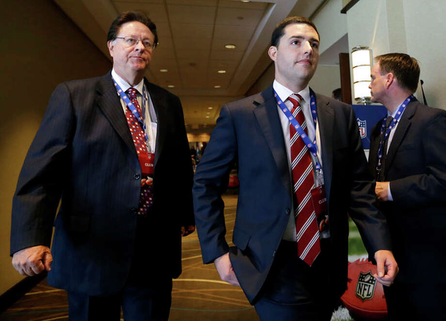 San Francisco 49ers football team owner John York, left, walks through a hotel with his son, 49ers CEO Jed York, during a break in the NFL spring meeting in Boston, Tuesday, May 21, 2013. Later Tuesday, owners will vote on the sites of the 50th and 51st Super Bowls. The San Francisco Bay Area and Florida are bidding for the 2016 game. The loser for that game will face Houston for the right to hold the 2017 Super Bowl. (AP Photo/Elise Amendola) / AP
