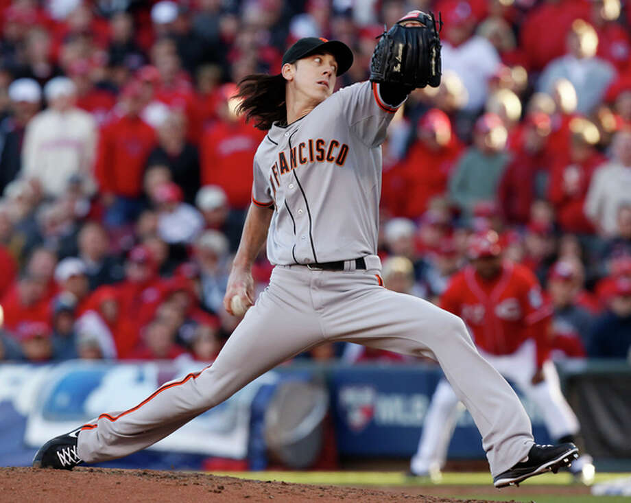 San Francisco Giants relief pitcher Tim Lincecum throws against the Cincinnati Reds in the fifth inning of Game 4 of the National League division baseball series, Wednesday, Oct. 10, 2012, in Cincinnati. (AP Photo/David Kohl) / FR51830 AP