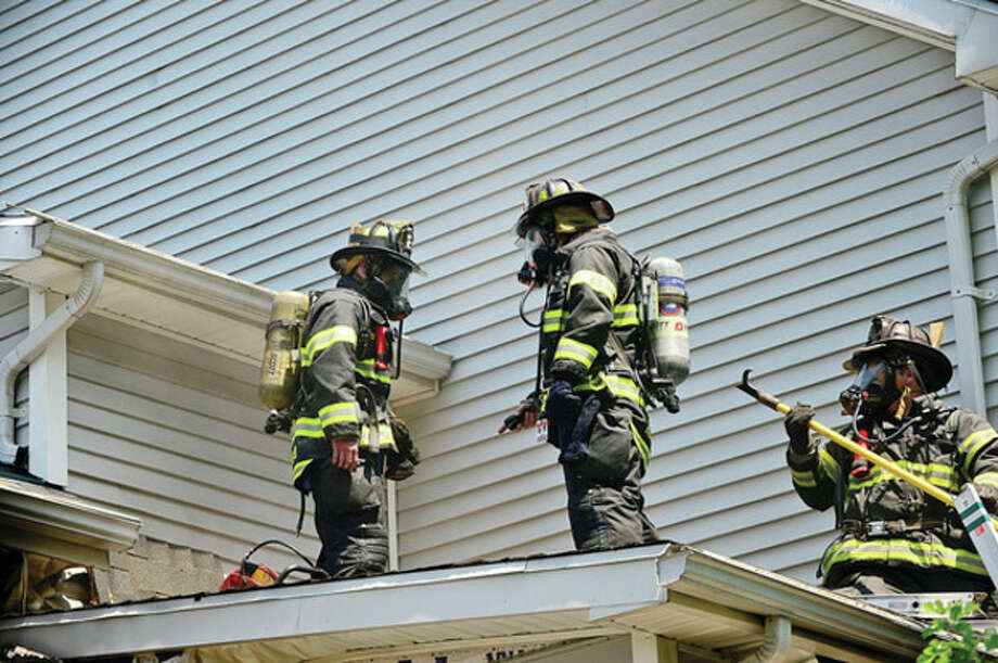 Norwalk firefighters battle a blaze at 43 East Ave Tuesday afternoon.Hour photo / Erik Trautmann / (C)2013, The Hour Newspapers, all rights reserved