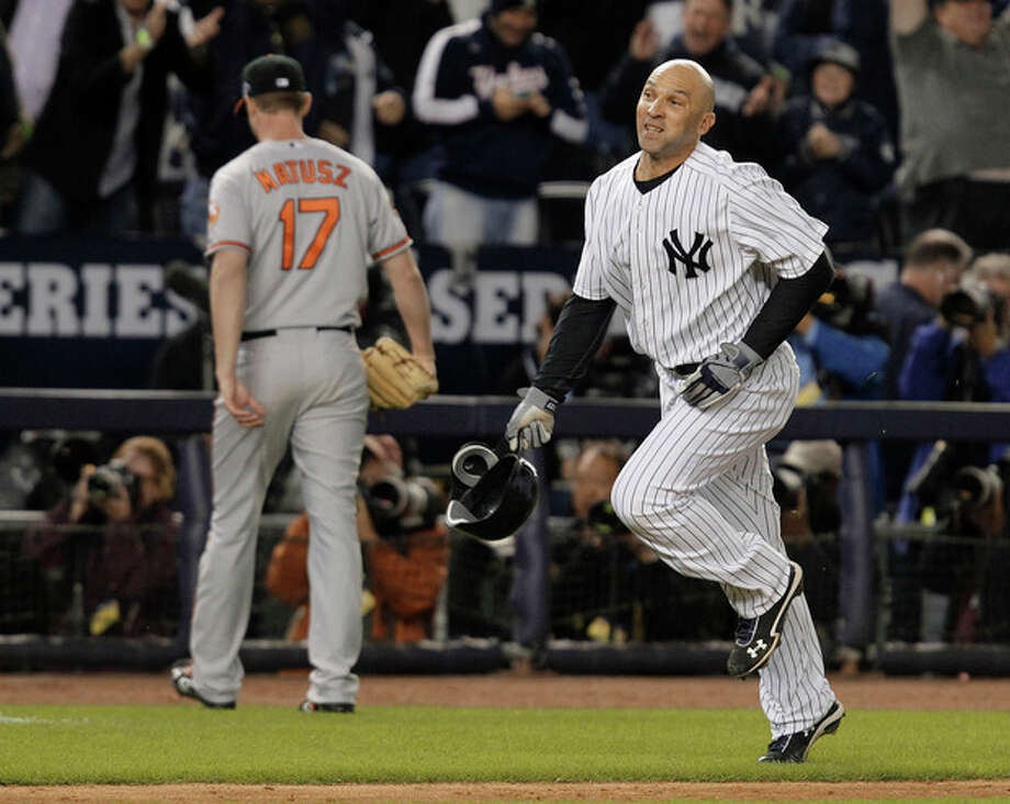 New York Yankees' Raul Ibanez (27) runs past Baltimore Orioles pitcher Brian Matusz after hitting the game-winning home run during the 12th inning of Game 3 of the American League division baseball series Wednesday, Oct. 10, 2012, in New York. The Yankees won 3-2. (AP Photo/Kathy Willens) / AP