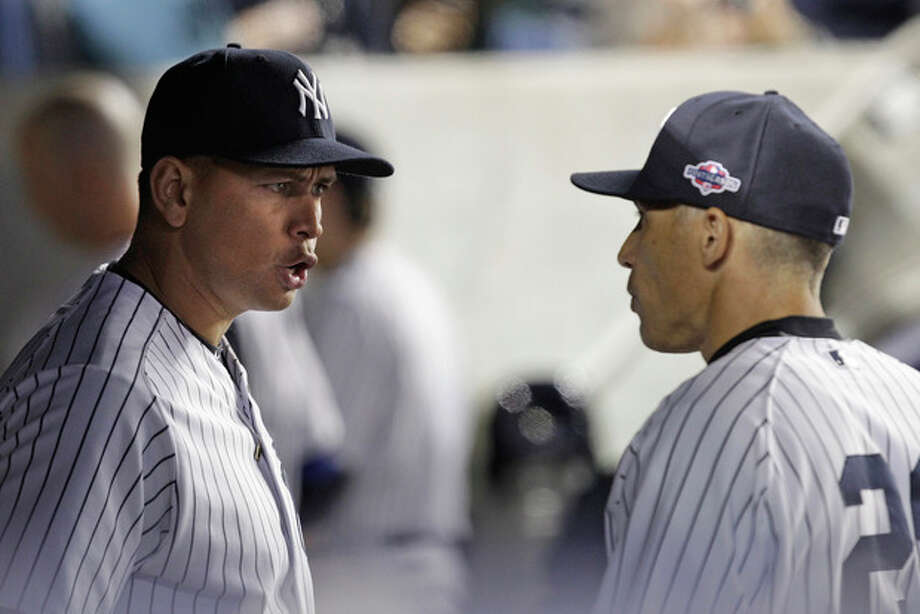 New York Yankees' Alex Rodriguez, left, talks to manager Joe Girardi during the 10th inning of Game 3 against the Baltimore Orioles in the American League division baseball series Wednesday, Oct. 10, 2012, in New York. The Yankees won 3-2. (AP Photo/Kathy Willens) / AP