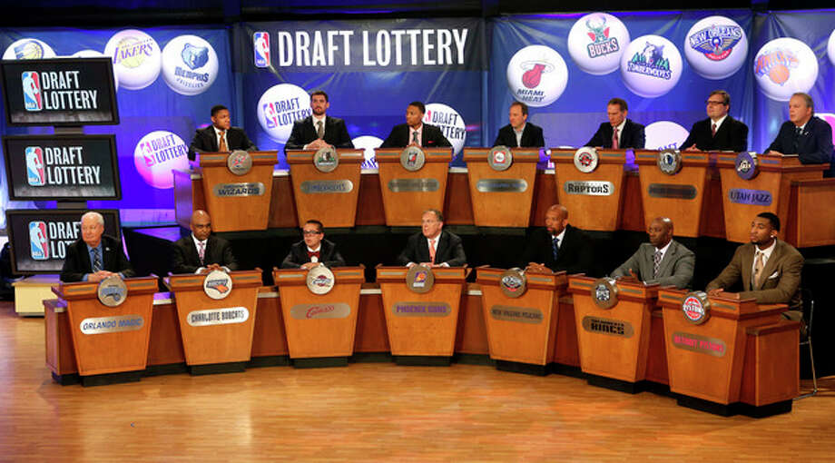 NBA basketball team representatives sit onstage at the start of the NBA draft lottery, Tuesday, May 21, 2013 in New York. (AP Photo/Jason DeCrow) / FR103966 AP
