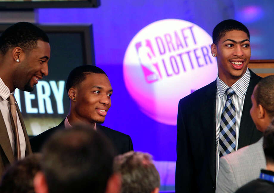 NBA basketball players, from left, Detroit Pistons' Andre Drummond, Portland Trailblazers' Damian Lillard and New Orleans Pelicans' Anthony Davis mingle onstage before the NBA basketball draft lottery, Tuesday, May 21, 2013 in New York. (AP Photo/Jason DeCrow) / FR103966 AP