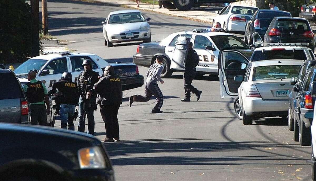 Hour Photo Alex von Kleydorff; Norwalk police swarm a house on Hillside St in response to a man with a high powered rifle.