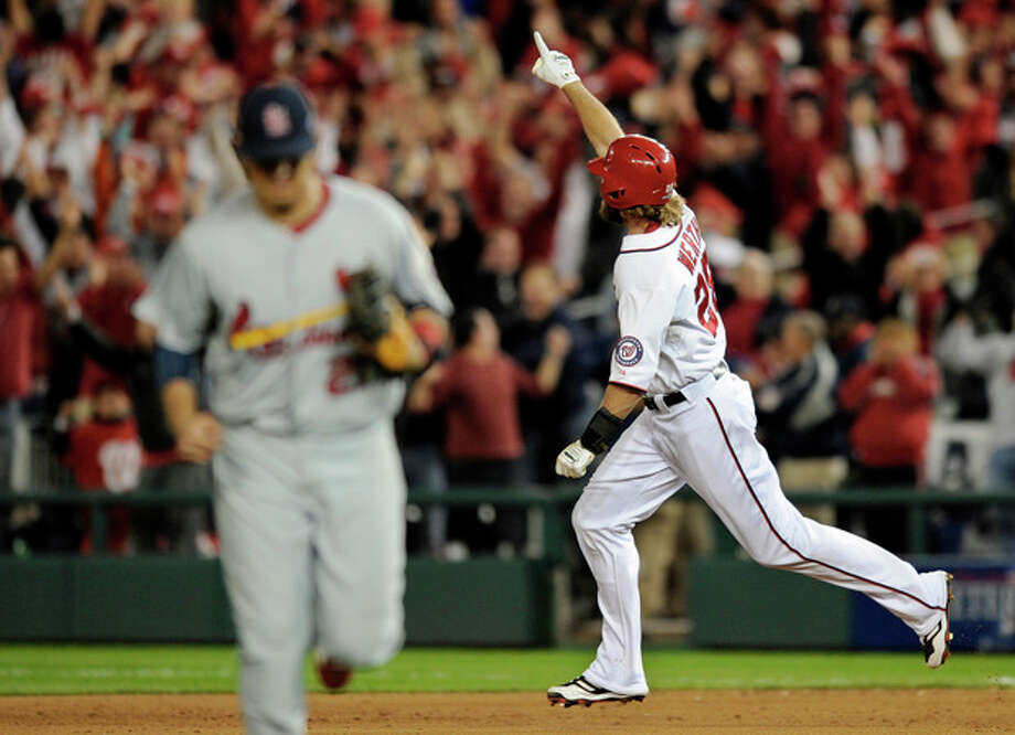 Washington Nationals' Jayson Werth, right, reacts as he rounds the bases after hitting the game-winning solo home run in the ninth inning of Game 4 of the National League division baseball series against the St. Louis Cardinals on Thursday, Oct. 11, 2012, in Washington. Washington won 2-1. (AP Photo/Nick Wass) / FR67404 AP