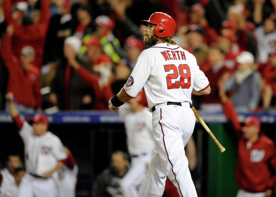Washington Nationals' Jayson Werth watches his game-winning solo home run in the ninth inning of Game 4 of the National League division baseball series against the St. Louis Cardinals on Thursday, Oct. 11, 2012, in Washington. Washington won 2-1. (AP Photo/Nick Wass) / FR67404 AP