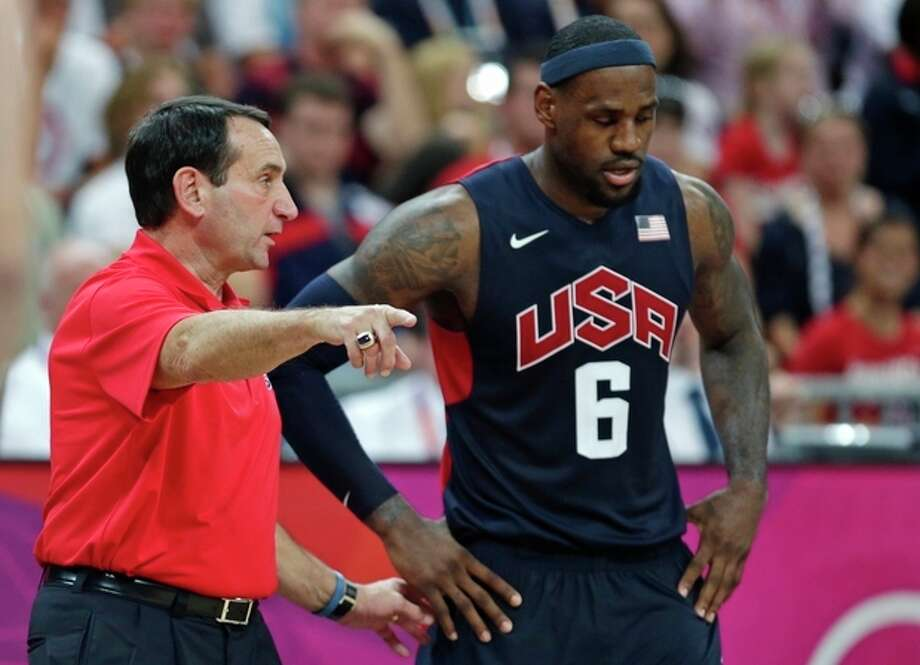 FILE- In this Aug. 4, 2012, file photo, United States coach Mike Krzyzewski talks with LeBron James during a men's basketball game against Lithuania at the 2012 Summer Olympics in London. A person with knowledge of the decision says Krzyzewski has agreed to return as U.S. men's Olympic basketball coach. He was originally expected to step down but instead will attempt to lead the Americans to a third straight gold medal, the person tells The Associated Press on condition of anonymity because no official announcement has been made. (AP Photo/Charles Krupa, File) / AP