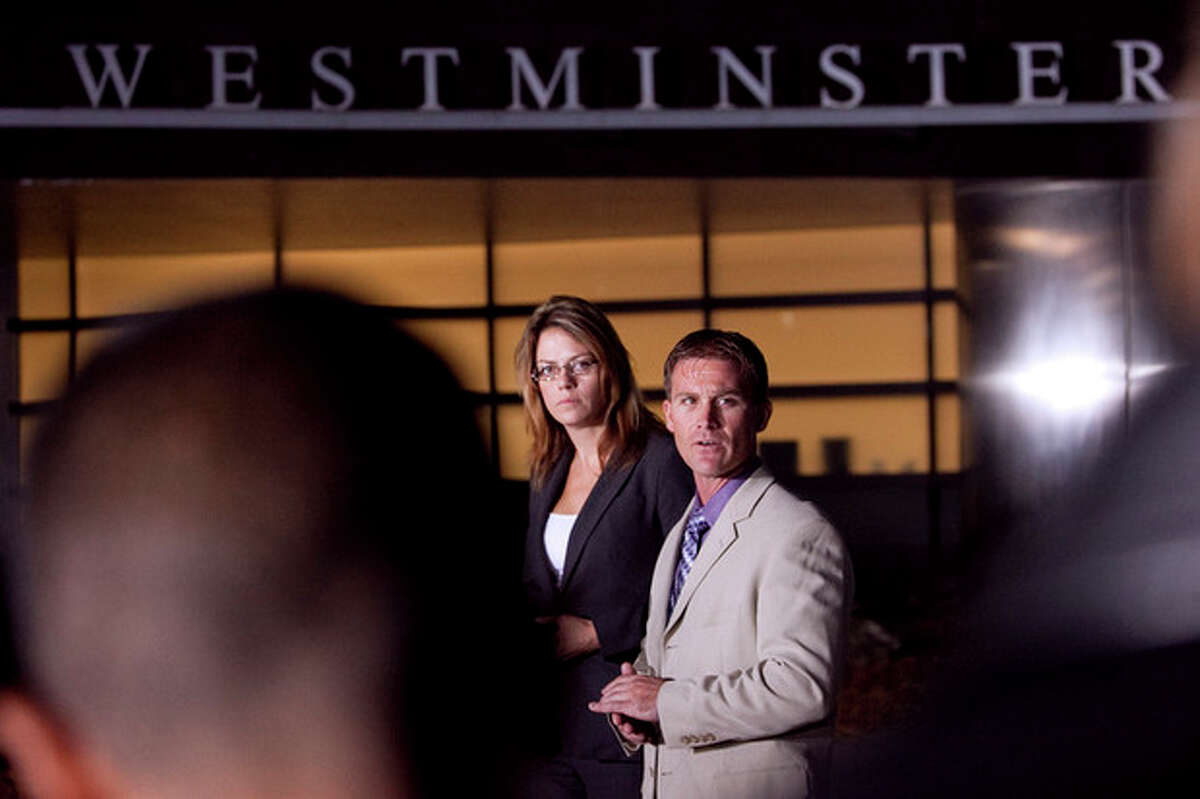 Arvada Police spokeswoman Jill McGranahan, left, and Westminster Police spokesman Trevor Materasso, right, address the media regarding a body found lat Wednesday in Parttridge Park in Arvada during a press conference at the Westminister Police Department Thursday, Oct. 11, 2012 in Westminister, Colo. The search missing 10-year-old Jessica Ridgeway will continue, police said Thursday. (AP Photo/Barry Gutierrez)