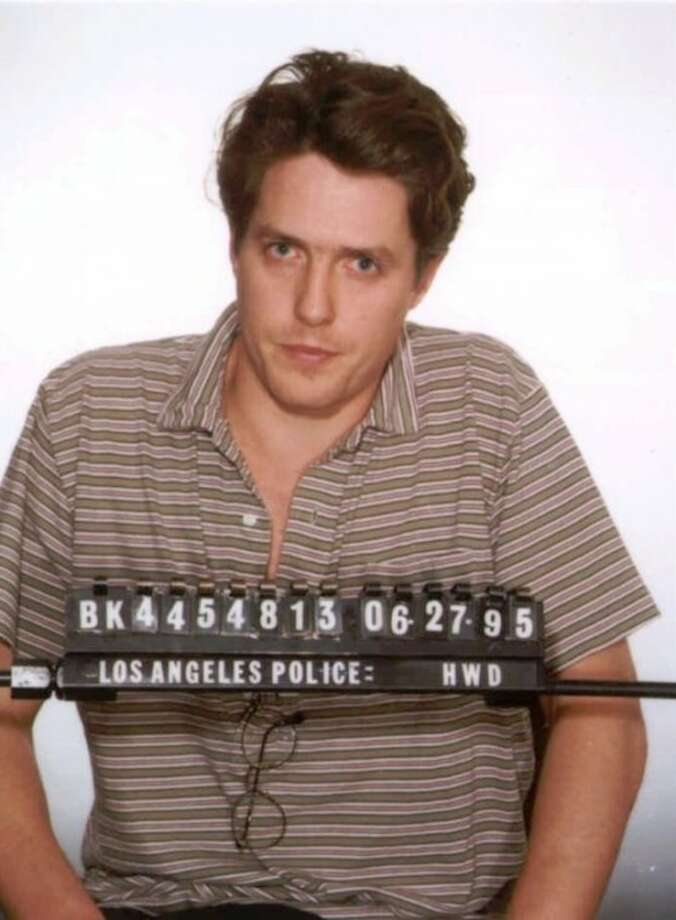 FILE - This June 27, 1995 file photo shows a Los Angeles police booking photo of British actor Hugh Grant who was arrested by Hollywood vice officers and charged with lewd conduct involving a prostitute. Interviews and surveys of officers at 200 police departments nationwide since 2008 found most consider targeting customers the best way to curb prostitution, because they fear publicity about the charges more than fines or even jail time. The shaming techniques are particularly damaging because they publicly humiliate people prior to trial, for what remains a relatively minor offense, said Laurie Shanks, a professor at Albany Law School. Grant emerged little worse for the wear after being arrested. (AP Photo/ho)