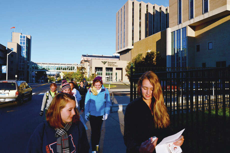 Hannah Skipper and Hasllie King lead nearly a dozen other members of the Brien McMahon High School Center for Youth Leadership one of their Safe Haven Walks Saturday morning from Bridgeport Hospital to Yale New Haven Hospital to raise awareness of Connecticut's Safe Haven Law for Newborns .Hour photo / Erik Trautmann / (C)2012, The Hour Newspapers, all rights reserved