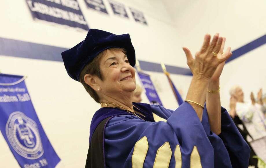 Dr. Antoinette Iadarola, president of Lauralton Hall, applauds the 2016 graduating class. Photo: Provided Photo