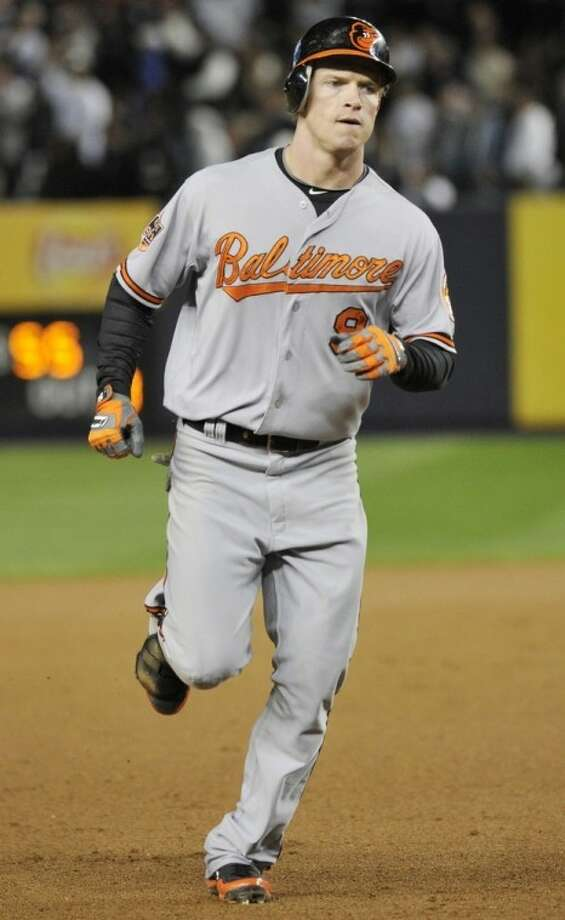Baltimore Orioles' Nate McLouth runs the bases after hitting a home run during the fifth inning of Game 4 of the American League division baseball series against the New York Yankees, Thursday, Oct. 11, 2012, in New York. (AP Photo/Bill Kostroun)
