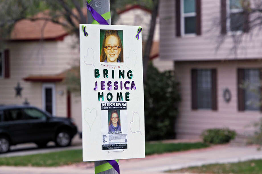 A missing person sign is posted on a lamp post near the home of ten-year-old Jessica Ridgeway where police continue to search for the missing girl in Westminster, Colo., on Wednesday, Oct. 10, 2012. The youngster has been missing since she left her home Friday morning on her way to school. (AP Photo/Ed Andrieski) / AP
