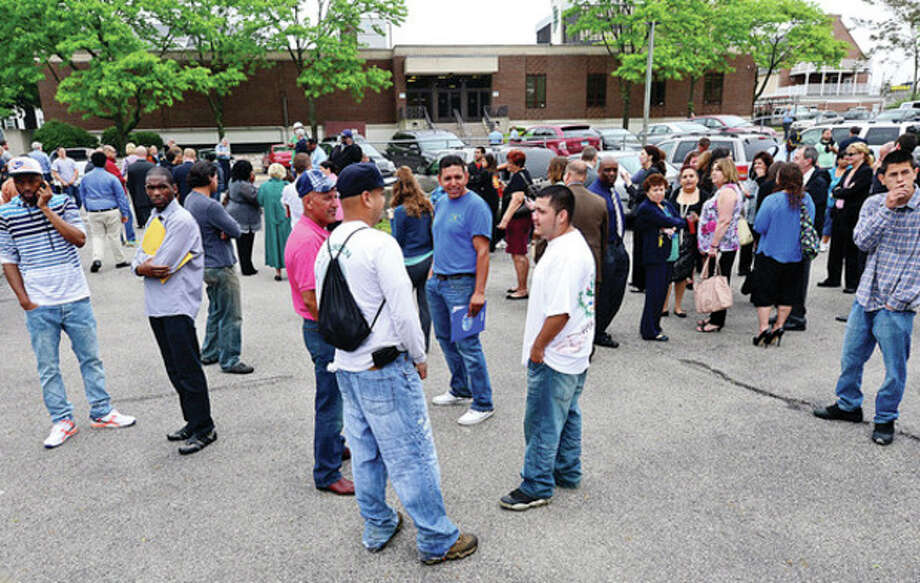 Hour photo / Erik TrautmannPeople evacuate Norwalk Superior Court after a threatening phone call sparked a bomb scare Wednesday. / (C)2013, The Hour Newspapers, all rights reserved