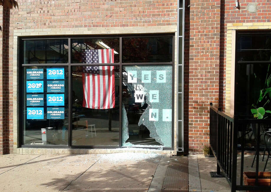 This photo provided by Courtney Grimm shows the shattered glass outside of President Barack Obama's Denver campaign office on Friday, Oct. 12, 2012. Denver police say someone has fired a shot through the window of the campaign office. Police spokeswoman Raquel Lopez says people were inside the office when the shooting happened Friday afternoon, but no one was injured. A large panel of glass was left shattered at the office on West Ninth Avenue near Acoma Street. Lopez says investigators are looking at surveillance video but have not yet confirmed a description of a vehicle that might be linked to the shooting. Police didn't immediately release other details while detectives pursue leads. (AP Photo/Courtney Grimm) / Courtney Grimm
