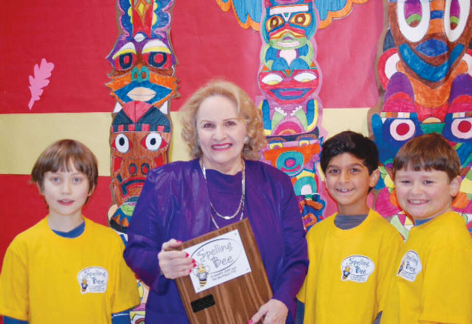 Pictured above, Northeast Elementary School Principal Constance Stevenson accepts a commemorative plaque from the third, fourth, and fifth-grade winners of the R² Spelling Bee. Also pictured, from left to right, are: Christian Rubino, Arjun Batra, and Gordon Ensign, each winners of the spelling bee for their respective grades.