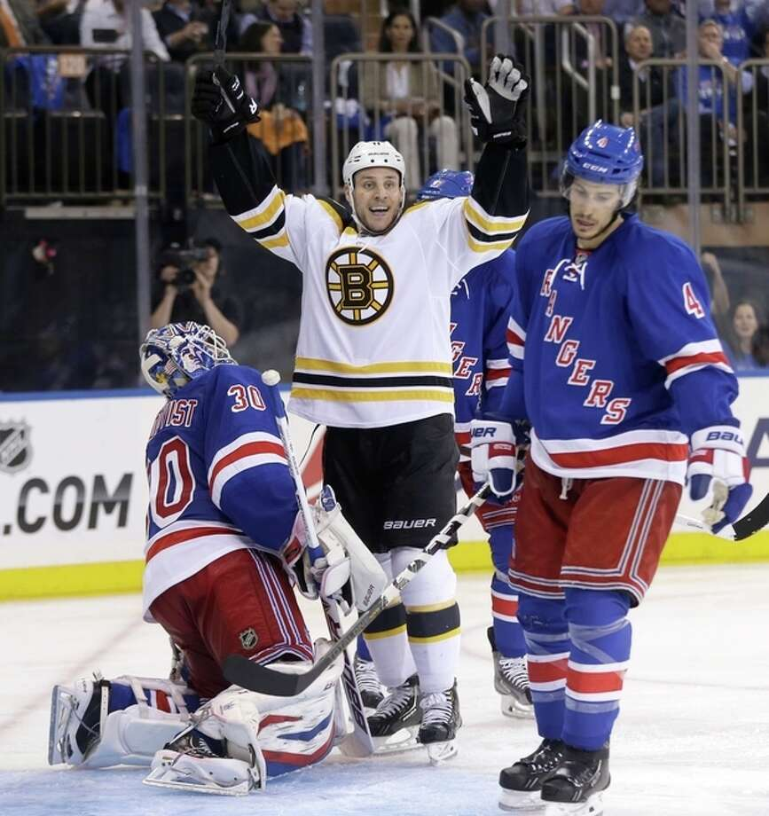 Boston Bruins' Gregory Campbell, center, reacts along with New York Rangers goalie Henrik Lundqvist, left, and Michael Del Zotto to a goal by Boston Bruins' Johnny Boychuk during the third period in Game 3 of the Eastern Conference semifinals in the NHL hockey Stanley Cup playoffs in New York Tuesday, May 21, 2013, in New York. The Bruins won 2-1 and lead the best-of-seven games series 3-0. (AP Photo/Seth Wenig) / AP