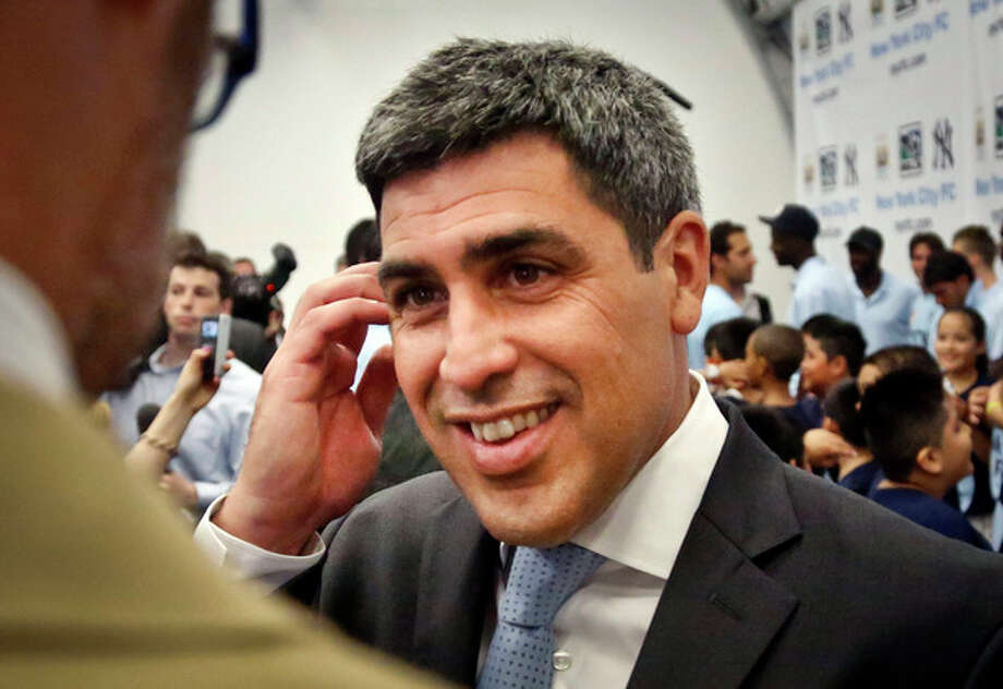 Former U.S. national team soccer captain Claudio Reyna reacts during an interview on Wednesday, May 22, 2013, in New York. Reyna was named director of football for the New York City Football Club, the 20th expansion team for Major League Soccer acquired through a partnership between MCFC and the New York Yankees. (AP Photo/Bebeto Matthews) / AP