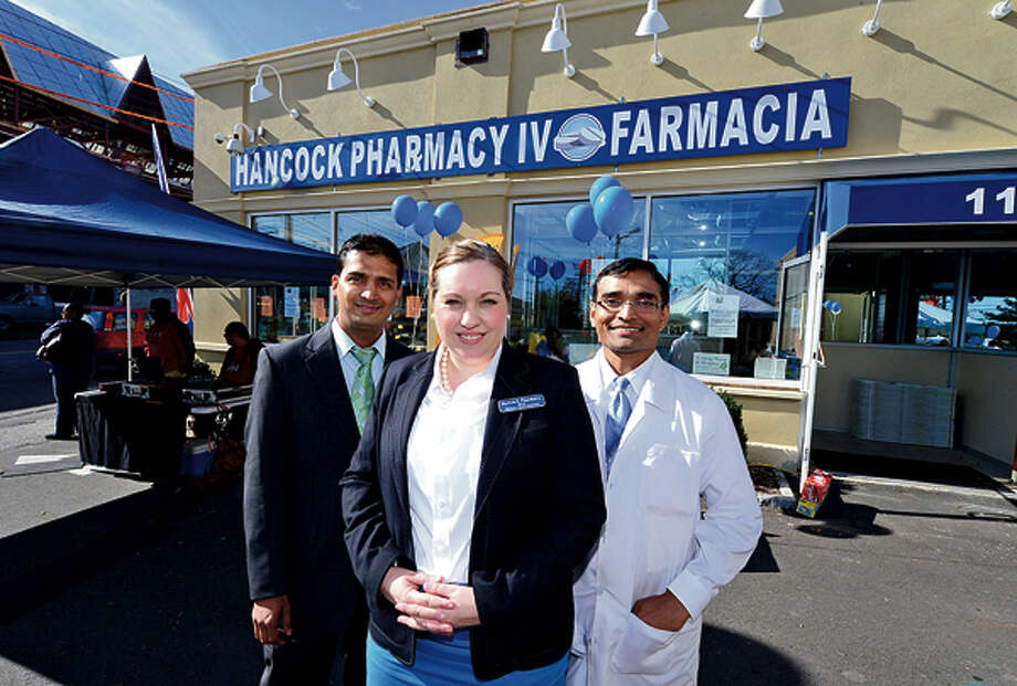 Hancock Pharmacy pharmacy manager, Laks Pudipeddi, Director Dawn Paqariello-Reynolds and pahrmacist Ram Chervu at the pharmacy's grand opening Wednesday. Hour photo / Erik Trautmann / (C)2012, The Hour Newspapers, all rights reserved