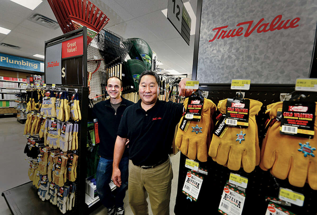 Wilton Hardware manager Andy Ecksman and owner Tom Sato prepare their store for their official opening later this month. Hour photo / Erik Trautmann
