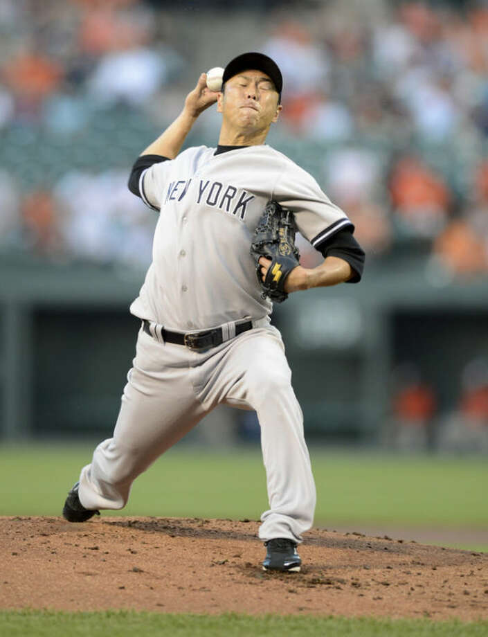New York Yankees starting pitcher Hiroki Kuroda, of Japan, delivers a pitch against the Baltimore Orioles during the first inning of a baseball game, Wednesday, May 22, 2013, in Baltimore. (AP Photo/Nick Wass)
